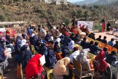 Students and teachers at the distribution area, Azad Kashmir, Pakistan