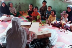 Educational materials are handover from house to house Aceh, Indonesia